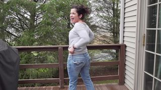Frisky brunette with a beautiful smile shows off her big booty on camera